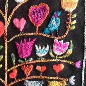 hartjes, tulpen en een vogel