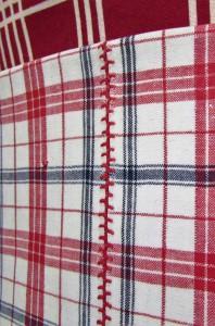 vries (lapje geruite katoen aan de bovenkant van de schort) met naadverbinding